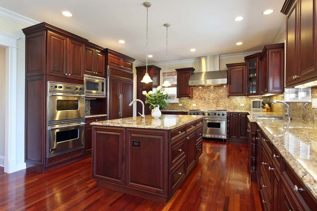 Kitchen with Cherry Wood Cabinets - HDRE Corporation